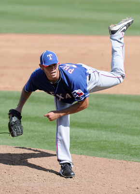 PEORIA, AZ - MARCH 01:  Zach Phillips #67 of the Texas Rangers pitches against the Seattle Mariners during spring training at Peoria Stadium on March 1, 2011 in Peoria, Arizona.  (Photo by Harry How/Getty Images)