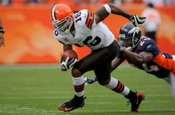 DENVER - SEPTEMBER 20:  Joshua Cribbs #16 of the Cleveland Browns makes a reception as Champ Bailey #24 of the Denver Broncos defends during NFL action at Invesco Field at Mile High on September 20, 2009 in Denver, Colorado. The Broncos defeated the Brown