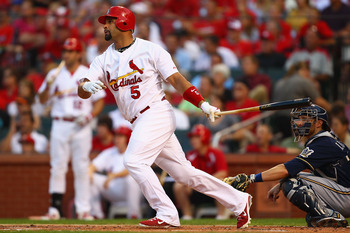 ST. LOUIS, MO - AUGUST 11: Albert Pujols #5 of the St. Louis Cardinals hits a solo home run against the Milwaukee Brewers at Busch Stadium on August 11, 2011 in St. Louis, Missouri.  (Photo by Dilip Vishwanat/Getty Images)