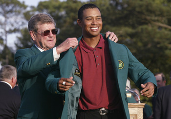 Tiger Woods receiving the Green jacket after winning the 2002 Masters