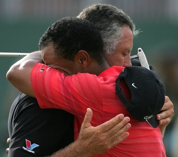 Tiger Woods hugging caddie Steve Williams after winning the 2006 British Open Championship