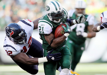 EAST RUTHERFORD, NJ - NOVEMBER 21:  LaDainian Tomlinson #21 of the New York Jets runs the ball against Earl Mitchell #92 of the Houston Texans on November 21, 2010 at the New Meadowlands Stadium in East Rutherford, New Jersey.  (Photo by Jim McIsaac/Getty