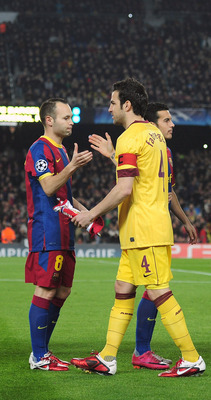 BARCELONA, SPAIN - MARCH 08:  Cesc Fabregas (C), the Arsenal captain, shakes hands with Andres Iniesta (3L) of Barcelona before the UEFA Champions League round of 16 second leg match between Barcelona and Arsenal at the Nou Camp Stadium on March 8, 2011 i