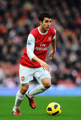 LONDON, UNITED KINGDOM - JANUARY 22:  Cesc Fabregas of Arsenal runs with the ball during the Barclays Premier League match between Arsenal and Wigan Athletic at the Emirates Stadium on January 22, 2011 in London, England.  (Photo by Mike Hewitt/Getty Imag