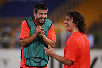 ROME - MAY 26:  Carles Puyol of Barcelona and Gerard Pique of Barcelona attend the Barcelona training session prior to UEFA Champions League Final versus Manchester United at the Stadio Olimpico on May 26, 2009 in Rome, Italy.  (Photo by Shaun Botterill/G
