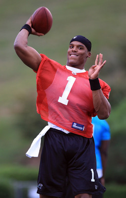 SPARTANBURG, SC - JULY 30:  Cam Newton #1 of the Carolina Panthers throws a pass during training camp at Wofford College on July 30, 2011 in Spartanburg, South Carolina.  (Photo by Streeter Lecka/Getty Images)