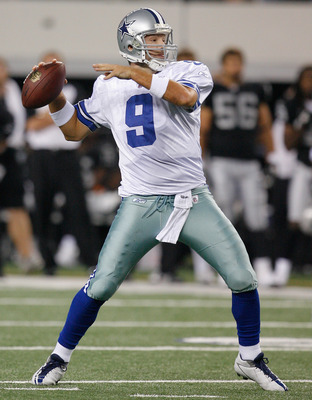 ARLINGTON, TX - AUGUST 12:  Tony Romo #9 looks to pass the ball during the preseason game against the Oakland Raiders at Dallas Cowboys Stadium on August 12, 2010 in Arlington, Texas.  (Photo by Tom Pennington/Getty Images)