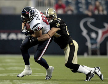HOUSTON - AUGUST 22:  Tight end Joel Dreesen #85 o the Houston Texans is tackled by linebacker Troy Evans #54 of the New Orleans Saints on August 22, 2009 in Houston, Texas.  (Photo by Bob Levey/Getty Images)