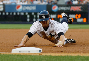 NEW YORK, NY - AUGUST 10:  Brett Gardner #11 of the New York Yankees slides in safely into third against the Los Angeles Angels of Anaheim on August 10, 2011 at Yankee Stadium in the Bronx borough of New York City.  (Photo by Mike Stobe/Getty Images)