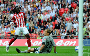 LONDON, ENGLAND - APRIL 17:  Kenwyne Jones of Stoke scores their third goal past Jussi Jaaskelainen of Bolton during the FA Cup sponsored by E.ON semi final between match Bolton Wanderers and Stoke City at Wembley Stadium on April 17, 2011 in London, Engl