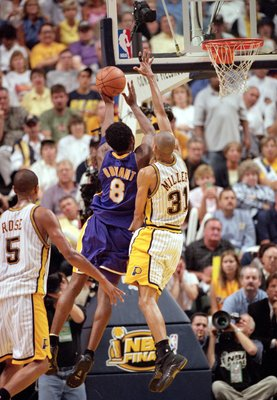 16 Jun 2000:  Kobe Bryant #8 of the Los Angeles Lakerstries to shoot against Reggie Miller #31 of the Indiana Pacers during the NBA Finals Game 4 at the Conseco Fieldhouse in Indianapolis, Indiana.  The Lakers defeated the Pacers in overtime 120-118.  NOT