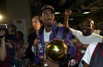 15 Jun 2001:  Kobe Bryant #8 of the Los Angeles Lakers celebrates with the Championship trophy following game five of the NBA Finals against the Philadelphia 76ers at the First Union Center in Philadelphia, Pennsylvania.  The Lakers won 108-86 to take the