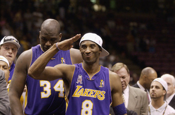 EAST RUTHERFORD, NJ - JUNE 12: Kobe Bryant #8 of the Los Angeles Lakers salutes the crowd after defeating the New Jersey Nets in Game four of the 2002 NBA Finals at Continental Airlines Arena in East Rutherford, New Jersey on June 12, 2002. The Lakers won