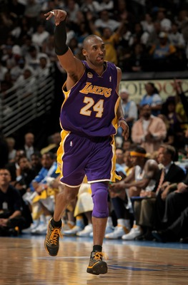 DENVER - APRIL 26:  Kobe Bryant #24 of the Los Angeles Lakers celebrates after sinking a three point basket against the Denver Nuggets in Game Three of the Western Conference Quarterfinals during the 2008 NBA Playoffs at the Pepsi Center on April 26, 2008