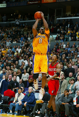 LOS ANGELES - FEBRUARY 21:  Kobe Bryant #8 of the Los Angeles Lakers puts a shot up past Scottie Pippen #33 of the Portland Trail Blazers during the NBA game at Staples Center on February 21, 2003 in Los Angeles, California.  The Lakers won 92-84.  NOTE T