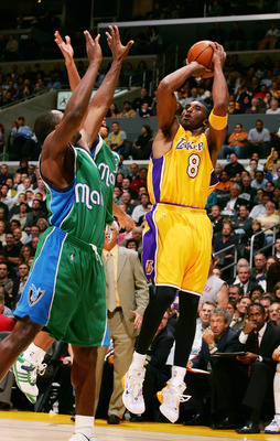 LOS ANGELES - DECEMBER 20:  Kobe Bryant #32 of the Los Angeles Lakers makes a jump shot in the third quarter of the game against the Dallas Mavericks on December 20, 2005 at the Staples Center in Los Angeles, California. Bryant scored a personal best of 6