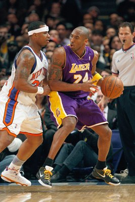 NEW YORK - FEBRUARY 2:  Kobe Bryant #24 of the Los Angeles Lakers looks to move the ball against Quentin Richardson #23 of the New York Knicks on February 2, 2009 at Madison Square Garden in New York City. NOTE TO USER: User expressly acknowledges and agr