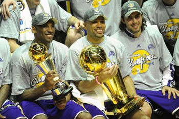 ORLANDO, FL - JUNE 14:  Kobe Bryant #24 of the Los Angeles Lakers holds the Bill Russell MVP trophy and Derek Fisher #2 of the Lakers holds the Larry O'Brien trophy after defeating the Orlando Magic in Game Five of the 2009 NBA Finals on June 14, 2009 at