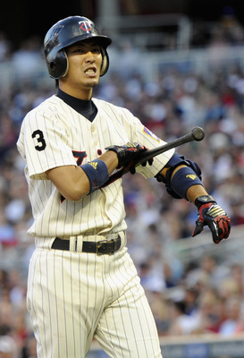 MINNEAPOLIS, MN - AUGUST 9: Tsuyoshi Nishioka #1 of the Minnesota Twins reacts to a strike during his at bat against the Boston Red Sox in the first inning with the bases loaded on August 9, 2011 at Target Field in Minneapolis, Minnesota. Tsuyoshi Nishiok