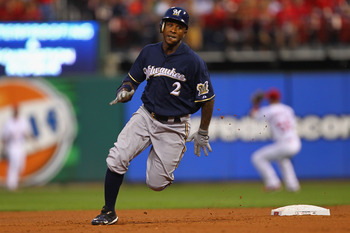 ST. LOUIS, MO - AUGUST 9: Nyjer Morgan #2 of the Milwaukee Brewers rounds second base to record a triple against the St. Louis Cardinals at Busch Stadium on August 9, 2011 in St. Louis, Missouri.  (Photo by Dilip Vishwanat/Getty Images)