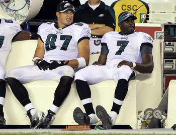 PHILADELPHIA, PA - AUGUST 11:  Michael Vick #7 and Brent Celek #87 of the Philadelphia Eagles look on from the bench against the Baltimore Ravens during a preseason game on August 11, 2011 at Lincoln Financial Field in Philadelphia, Pennsylvania.  (Photo