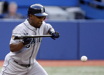 TORONTO, CANADA - JULY 19: Chone Figgins #9 of the Seattle Mariners bunts against the Toronto Blue Jays during MLB action at The Rogers Centre July 19, 2011 in Toronto, Ontario, Canada. (Photo by Abelimages/Getty Images)