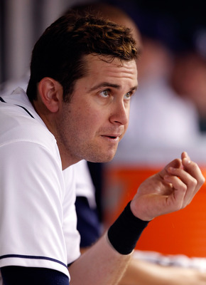 ST. PETERSBURG, FL - AUGUST 02:  Infielder Evan Longoria #3 of the Tampa Bay Rays watches his team from the bench against the Toronto Blue Jays during the game at Tropicana Field on August 2, 2011 in St. Petersburg, Florida.  (Photo by J. Meric/Getty Imag