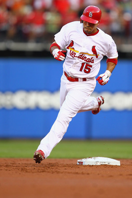 ST. LOUIS, MO - AUGUST 11: Rafael Furcal #15 of the St. Louis Cardinals rounds second base after hitting a solo home run against the Milwaukee Brewers at Busch Stadium on August 11, 2011 in St. Louis, Missouri.  (Photo by Dilip Vishwanat/Getty Images)