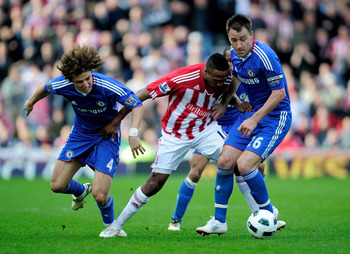 STOKE ON TRENT, ENGLAND - APRIL 02:  Ricardo Fuller of Stoke City battles for the ball with David Luiz (L) and John Terry of Chelsea during the Barclays Premier League match between Stoke City and Chelsea at the Britannia Stadium on April 2, 2011 in Stoke