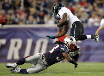 FOXBORO, MA - AUGUST 11:  Jamar Newsome #14 of the Jacksonville Jaguars is hit by Sergio Brown #38 of the New England Patriots on August 11, 2011 at Gillette Stadium in Foxboro, Massachusetts. The New England Patriots defeated the Jacksonville Jaguars 47-