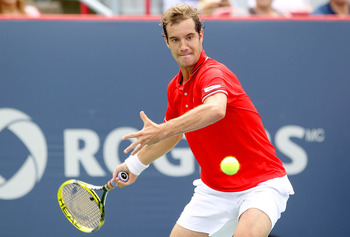 MONTREAL, QC - AUGUST 09:  Richard Gasquet of France returns a shot to Florina Mayer of Germany during the Rogers Cup at Uniprix Stadium on August 9, 2011 in Montreal, Canada.  (Photo by Matthew Stockman/Getty Images)