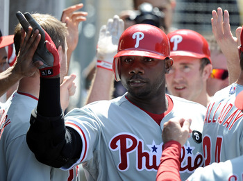 LOS ANGELES, CA - AUGUST 10:  Ryan Howard #6 of the Philadelphia Phillies celebrates with the dugout after a two run homerun to take a 9-7 lead over the Los Angeles Dodgers during the seventh inning at Dodger Stadium on August 10, 2011 in Los Angeles, Cal