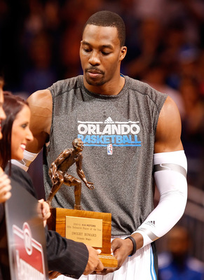 ORLANDO, FL - APRIL 19:  Dwight Howard #12 of the Orlando Magic receives his Defensive Player of the Year award just before the start of Game Two of the Eastern Conference Quarterfinals of the 2011 NBA Playoffs against the Atlanta Hawks on April 19, 2011
