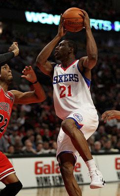 CHICAGO, IL - MARCH 28: Thaddeus Young #21 of the Philadelphia 76ers puts up for a shot against Taj Gibson #22 of the Chicago Bulls at the United Center on March 28, 2011 in Chicago, Illinois. NOTE TO USER: User expressly acknowledges and agrees that, by