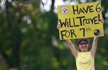 LATROBE, PA - JULY 29:  A fan holds up a sign during the Pittsburgh Steelers training camp on July 29, 2011 at St Vincent College in Latrobe, Pennsylvania.  (Photo by Jared Wickerham/Getty Images)
