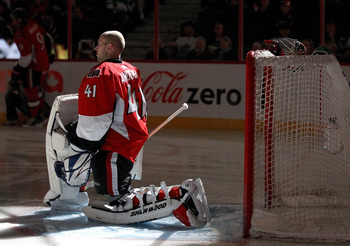 OTTAWA, CANADA - APRIL 2: Craig Anderson #41 of the Ottawa Senators stretches on the ice during player introductions prior to a game against the Toronto Maple Leafs at Scotiabank Place on April 2, 2011 in Ottawa, Ontario, Canada.  (Photo by Jana Chytilova