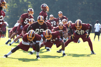 ASHBURN, VA - JULY 29:   Washington Redskins players stretch during the first day of training camp at Redskins Park on July 29, 2011 in Ashburn, Virginia.  (Photo by Mitchell Layton/Getty Images)