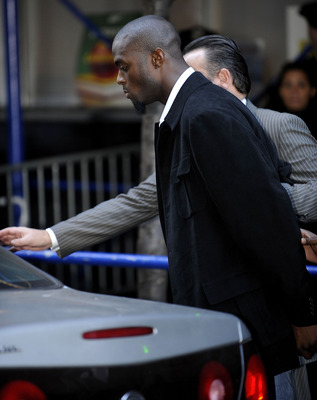 NEW YORK - DECEMBER 1:  Wide receiver Plaxico Burress of the New York Giants is led to a squad car for transport to his arraignment outside the NYPD 17th Precinct December 1, 2008 in New York City. Burress, who is expected to face a charge of criminal pos