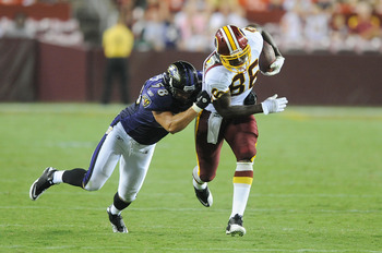 LANDOVER, MD - AUGUST 21:  Fred Davis #86 of the Washington Redskins is tackled during the preseason game by Jason Phillips #58 of the Baltimore Ravens at FedExField on August 21, 2010 in Landover, Maryland.  (Photo by Greg Fiume/Getty Images)