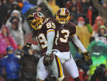 LANDOVER, MD - DECEMBER 12:  Santana Moss #89 of the Washington Redskins celebrates a 4th quarter touchdown during the game against the Tampa Bay Buccaneers  at FedExField on December 12, 2010 in Landover, Maryland. The Buccaneers defeated the Redskins 17