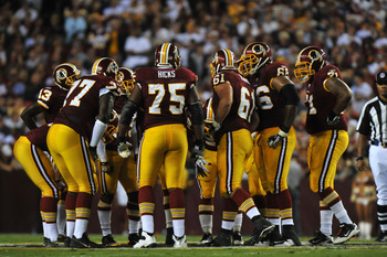 LANDOVER - SEPTEMBER 12:  The Washington Redskins offense huddles during the NFL season opener against the Dallas Cowboys at FedExField on September 12, 2010 in Landover, Maryland. The Redskins defeated the Cowboys 13-7. (Photo by Larry French/Getty Image