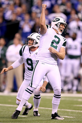 INDIANAPOLIS, IN - JANUARY 08:  Place kicker Nick Folk #2 and Steve Weatherford #9 of the New York Jets celebrates after Folk successfully kicked a game-winning a 32-yard field goal in the fourth quarter to win 17-16 against the Indianapolis Colts during