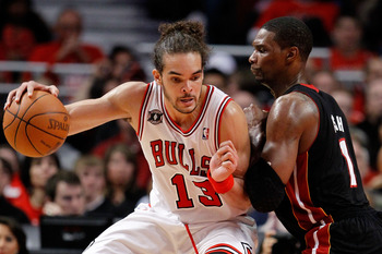 CHICAGO, IL - MAY 15:  Joakim Noah #13 of the Chicago Bulls drives against Chris Bosh #1 of the Miami Heat in Game One of the Eastern Conference Finals during the 2011 NBA Playoffs on May 15, 2011 at the United Center in Chicago, Illinois. The Bulls won 1
