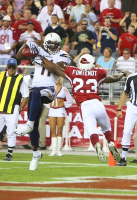 GLENDALE, AZ - AUGUST 22:  Legedu Naanee #11 of the San Diego Chargers  leaps for the touchdown in the second quarter against Wilrey Fontenot #23 of the Arizona Cardinals at the University of Phoenix Stadium on August 22, 2009 in Glendale, Arizona. (Photo