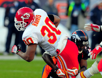 DENVER - DECEMBER 9:  Champ Bailey #24 of the Denver Broncos puts the stop on Gilbert Harris #30 of the Kansas City Chiefs in the second quarter of the game at Invesco Field at Mile High December 9, 2007 in Denver, Colorado.  (Photo by Steve Dykes/Getty I