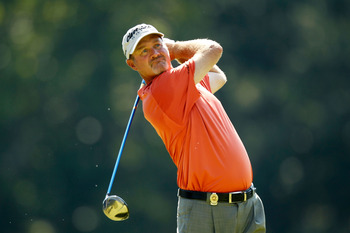 JOHNS CREEK, GA - AUGUST 11:  Jerry Kelly hits a tee shot on the 14th tee during the first round of the 93rd PGA Championship at the Atlanta Athletic Club on August 11, 2011 in Johns Creek, Georgia.  (Photo by Mike Ehrmann/Getty Images)