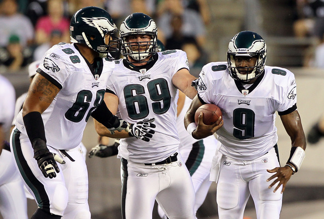 PHILADELPHIA, PA - AUGUST 11:  Vince Young #9 of the Philadelphia Eagles runs the ball against the Baltimore Ravens with teammates Austin Howard #68 and Evan Mathis #69 during their pre season game on August 11, 2011 at Lincoln Financial Field in Philadel