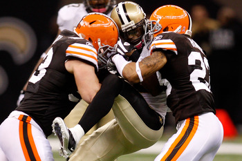 NEW ORLEANS - OCTOBER 24:  Marques Colston #12 of the New Orleans Saints is tackled by Joe Haden #23 and Matt Roth #53 of the Cleveland Browns at the Louisiana Superdome on October 24, 2010 in New Orleans, Louisiana.  The Browns defeated the Saints 30-17.