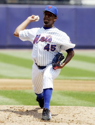 NEW YORK - JUNE 22:  Pedro Martinez #45 of the New York Mets delivers a pitch against the Cincinnati Reds on June 22, 2006 at Shea Stadium in the Flushing neighborhood of the Queens borough of New York City.  (Photo by Jim McIsaac/Getty Images)
