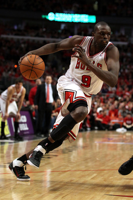 CHICAGO, IL - MAY 15:  Luol Deng #9 of the Chicago Bulls drives against the Miami Heat in Game One of the Eastern Conference Finals during the 2011 NBA Playoffs on May 15, 2011 at the United Center in Chicago, Illinois. The Bulls won 103-82. NOTE TO USER: